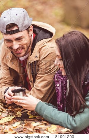 Smiling Man Giving Cup To Woman