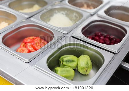 Sandwich bar salad fillings in metal containers. Meals for fast food take away in cafe. Vendor's equipment