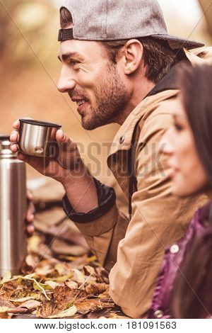 Young Man Holding Cup From Thermos