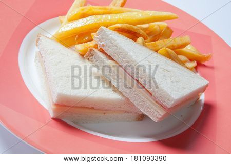 Sandwich With Ham, Cheese And Golden French Fries Potatoes
