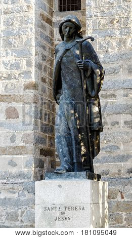 Avila Spain - April 18 2014: Sculpture of St. Teresa of Jesus in Avila bronze at the gates of the monastery of the Incarnation. Spain