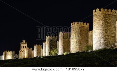 Walls of Avila Spain night image with artificial lighting.