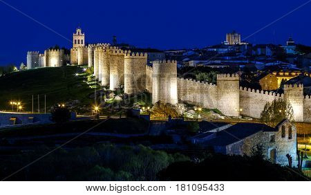 View of the city of Avila with its walls and blue skies in time. Spain