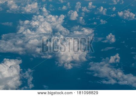 White soft clouds on idyllic blue sky celestial sphere on sunny day on fluffy overcast background. Upper layers of atmosphere