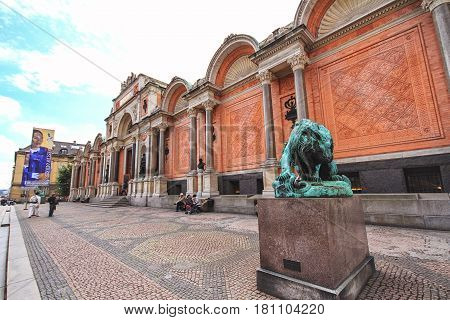 COPENHAGEN DENMARK - JUNE 15 2012: Ny Carlsberg Glyptotek facade and entrance with the bronze statue of lion fighting a snake. The art museum was inaugurated in 1906.