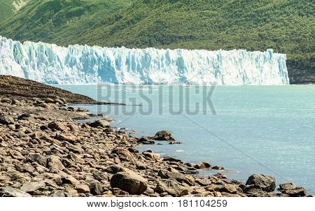 Panoramic lake view of Perito Moreno glaciar in argentinian Patagonia - World famous nature wonder of south american country of Argentina - Natural azure turquoise light blue color tones