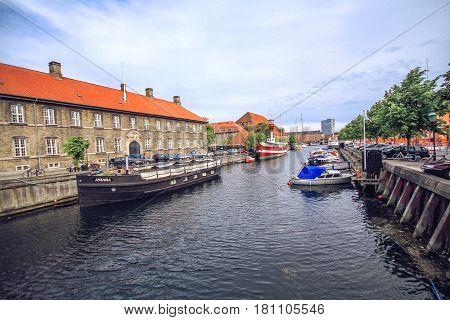 COPENHAGEN DENMARK - JUNE 15: Scenic summer view of the Old Town and canal in Copenhagen Denmark in a summer day in 2012