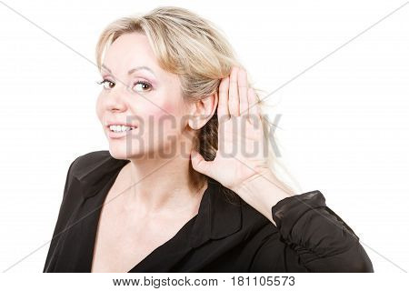 Gossip and chatter. Blonde mid aged woman listening hearing rumors information. Elegant mature female in black isolated on white.