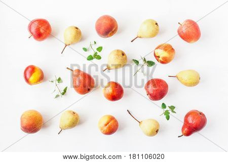 Fruit on white background. Pears apples peaches nectarines. Fruit pattern. Flat lay top view