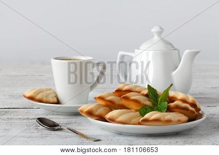 French madeleines cookies with cup of coffee