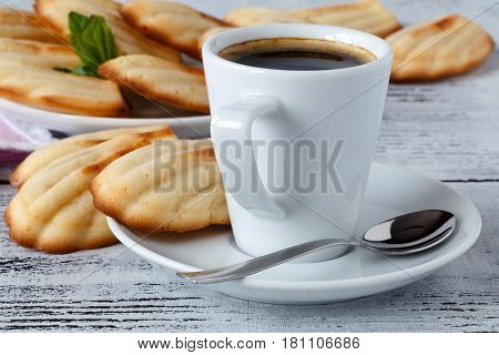 Homemade Madeleines / French Tea Cake Cookies Served In A Plate With Cup Of Coffee