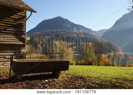 Hut and trough in the Swiss countryside