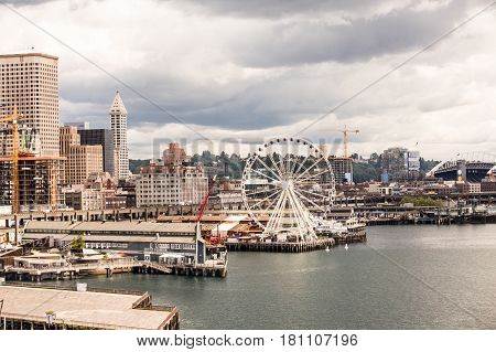 Seattle waterfront with boats freight and ferris wheel