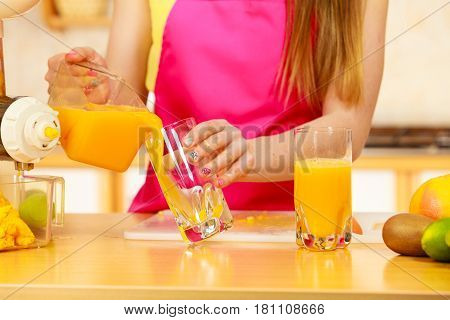 Woman Pouring Orange Juice Drink In Glass