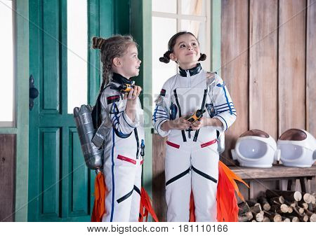 Girls In Astronaut Costumes With Jetpacks And Walkie Talkie