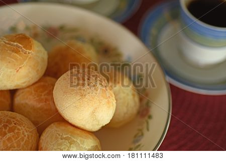 A batch of Brazilian cheese bread with coffee