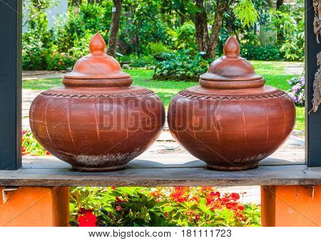 Closeup To Couple Of Brown Baked Clay Flagon In Ancient Tradition Northern Thai Style