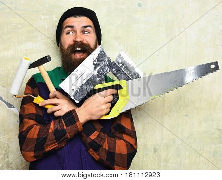 Bearded Man Holding Various Building Tools With Happy Face