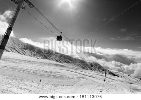 Black And White View On Gondola Lift And Ski Slope At Nice Sunny Day
