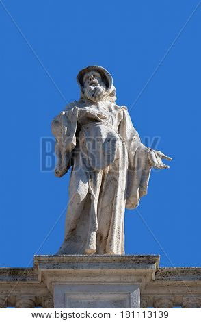 ROME, ITALY - SEPTEMBER 02: St. Francis of Paola, fragment of colonnade of St. Peters Basilica. Papal Basilica of St. Peter in Vatican, Rome, Italy on September 02, 2016.