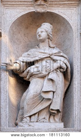 ROME, ITALY - SEPTEMBER 02: Saint Jeanne de Valois statue on the facade of Chiesa di San Luigi dei Francesi - Church of St Louis of the French, Rome, Italy on September 02, 2016.