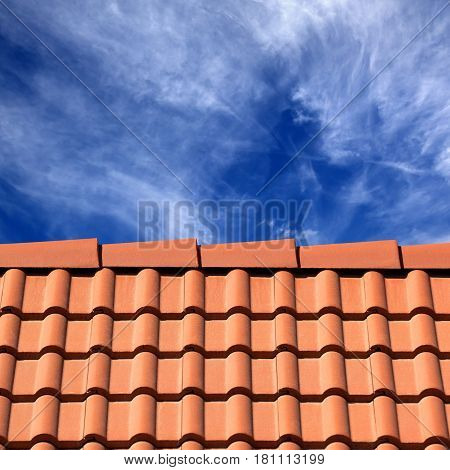 Roof tiles and sky with sunlight clouds at sun day