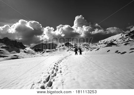 Black and white view on snow plateau with hikers. Turkey Central Taurus Mountains Aladaglar (Anti-Taurus) plateau Edigel (Yedi Goller)