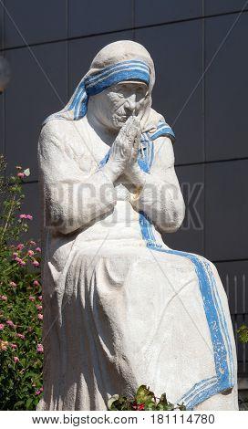 TIRANA, ALBANIA - SEPTEMBER 27: Mother Teresa statue in front St Paul's Cathedral in Tirana, Albania on September 27, 2016.