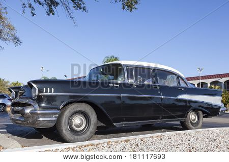 Naples Fl USA - March 18 2017: Black 1957 Chevrolet Belair parked on the street in Naples Florida United States