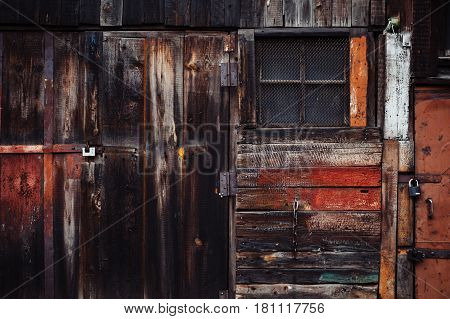 Colorful barn. Old wooden construction. Doorway. Retro.