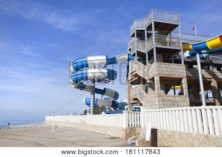 Empty water slides on Antalya's resort town beach after the season is closed (Turkey).