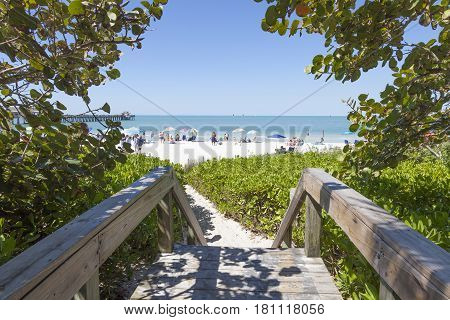 Naples Fl USA - March 18 2017: Access path to the beautiful white sand beach in Naples. Florida United States