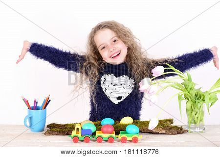 Happy Easter Girl With Colorful Eggs In Lorry, Pencils, Tulips