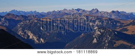 Stunning view from mount Niesen. Mountain ranges in the Bernese Oberland. Autumn day in the Swiss Alps.