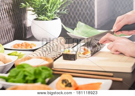 Japanese cuisine. Raw fish Sushi concept in the kitchen.