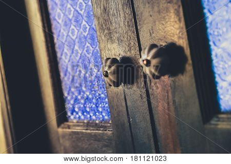 Closeup Antique Asian style wood door knob close.
