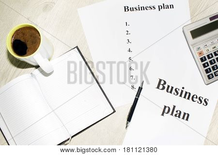 An inscription of the business plan, execution points, there is a calculator next to it.