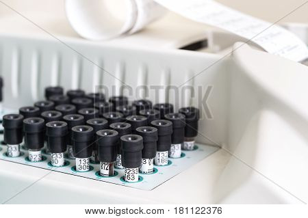 Test tubes arranged on medical trolley. Medical research