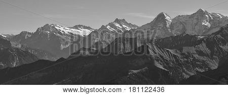 Mount Eiger and other high mountains in the Bernese Oberland. View of the Eiger north face. Mountains Wetterhorn EwigschneehornFinsteraarhorn Eiger and Monch. View from mount Niesen.