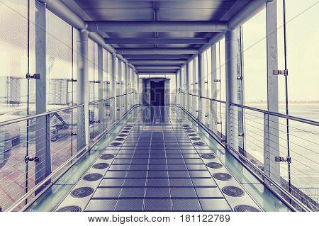 walkway for passengers boarding walkway in airport. Passengers walk to the gate for boarding