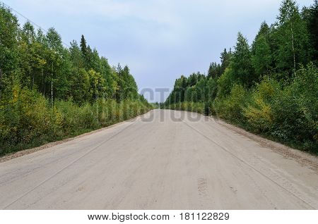 Sandy country road trough the woods in North Russia
