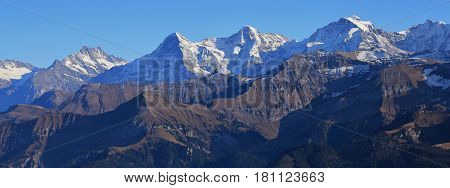 Snow capped mountains Finsteraarhorn Eiger Monch and Jungfrau. Famous mountains in Switzerland. View from mount Niesen.