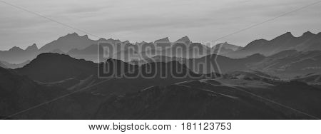 Silhouettes of mountain ranges in the Bernese Oberland. View from mount Niesen.