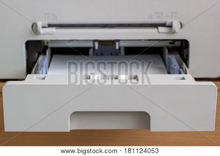 open tray of the copier with paper