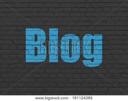 Web design concept: Painted blue text Blog on Black Brick wall background