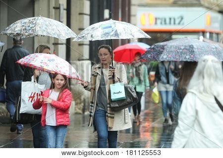 People With Umbrellas On Street