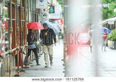 People On Rainy Day