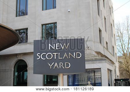 London, March 2017 - The world famous rotating sign outside New Scotland Yard, the headquarters of London's Metropolitan Police Service which is located at Westminster.