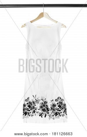 White basic mini dress on wooden clothes rack isolated over white