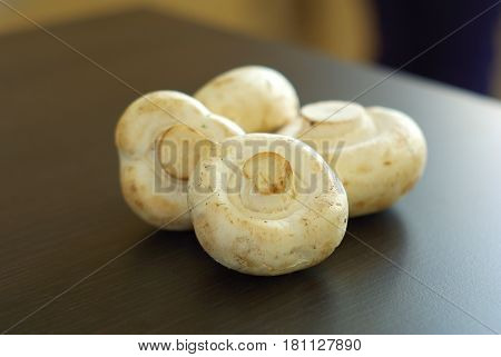 Champignon organic food ingredients. Fresh raw mushroom closeup. Dieting vegetarian meal. Natural whole champignons.